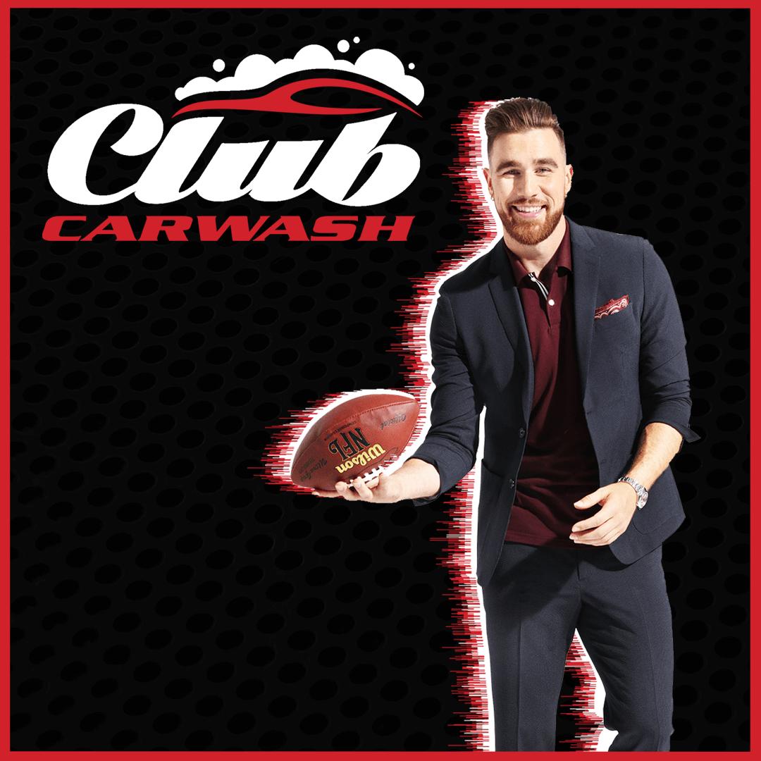 travis kelce holding football with club car wash logo